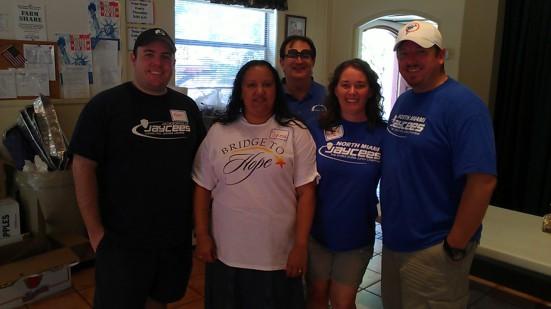 Jaycees help Bridge to Hope feed needy families in Homestead.